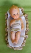 Statuina di Gesu' Bambino in culla-ceramica-West Germany-vintage-cm. 14,5x8x6