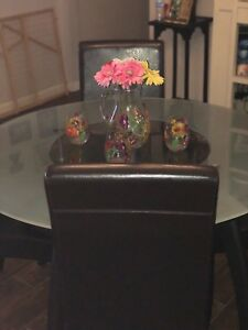 Glass dining table and chairs with middle lazy Susan