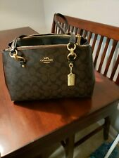 Gently used Coach F77881 Etta Carryall in Signature Canvas Brown Black