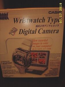 Casio Camera Watch W/ contents SHOWN + camera PC link Adapter USED IN GOOD SHAPE