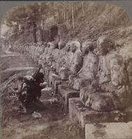 Japan Stereoview. Peasant Prays Before Row of Images of the God of Light, Nikko