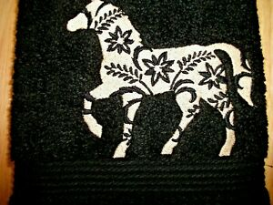 FLORAL HORSE EMBROIDERED ONTO A BLACK TOWEL