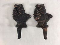 Set of 2 Heavy Cast Iron Santa Fireplace Stocking Holders