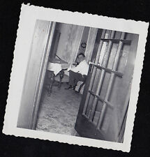 Old Antique Photograph Man Sitting in Retro Room Peeping Out Door