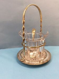 Pretty Plated Stand with a Glass Insert and Pierced Spoon