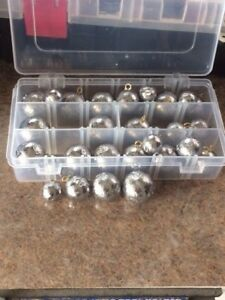 2 tackle boxes full of canon ball sinkers 1,2,3,and 4 oz 56 count