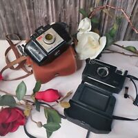 Two Vintage Kodak Cameras, Brownie 127 and Instamatic 56X, both with Carry Case