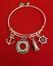 "Silver ""Nautical"" themed Charm Bracelet (lighthouse, ships wheel, anchor)"
