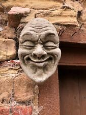 Stone face garden ornament wall hanging gurning statue funny smug smiler smile
