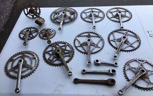 Job lot of vintage bicycle cranks.