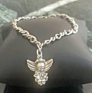 Avery Sterling Silver Medium Twist Bracelet with Retired Angel Flower Charm