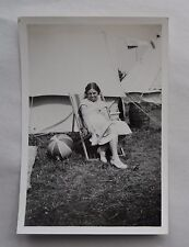 1930s B/W Photograph. Young Woman in Deckchair among White Tents. Camping