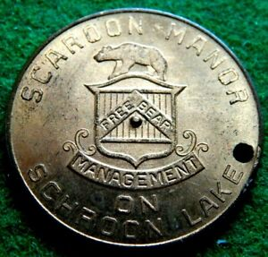 VINTAGE SPINNER AND GOOD LUCK TOKEN SCAROON MANOR FREE BEAR MANAGEMENT ON LAKE !