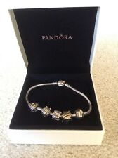 Pandora silver & gold bracelet and 5 charms authentic .very good condition