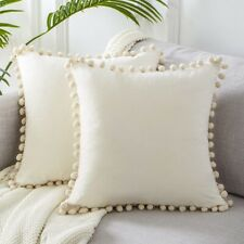 white color cotton cushion cover with pompoms 16 x 16 inches.