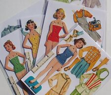 Vintage Paper Doll - 4 dolls w/plastic clips for attaching clothes - pre-cut