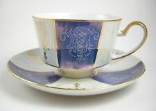 Lusterware Tea Cup and Saucer Set Made in Japan Blue and White with Gold Accents