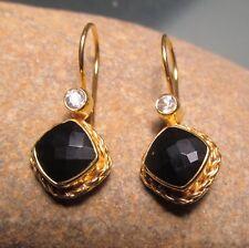 Sterling silver with 18k gold plate cut black onyx/rock quartz earrings.