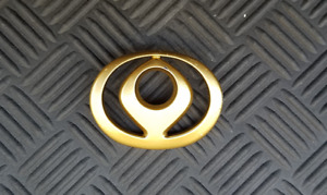 OEM Mazda Trunk Key Hole emblem. GOLD color. 6.5cm
