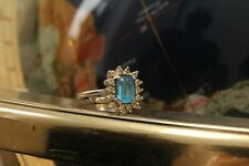 9ct white gold blue emerald cut topaz with 0.10ct (TCW) diamond halo ring 3.7g