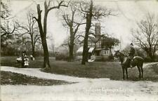 REAL PHOTO POSTCARD OF THE FOREST ENTRANCE, LEYTON, (NEAR STRATFORD), ESSEX
