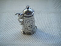 Vintage solid silver tankard charm with skier inside