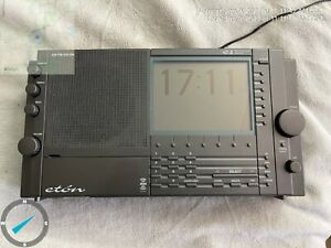 Eton E1XM radio and power cord