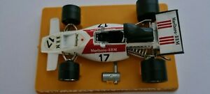 POLITOYS DIECAST FX4 B.R.M. FORMULA 1 RACE CAR IN THE RED AND WHITE