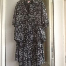 2 piece skirt and blouse size 12. black and white pattern