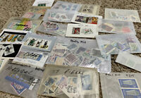 MINT STAMPS LOT IN GLASSINES FROM MANY WORLDWIDE COUNTRIES (NO U.S.)