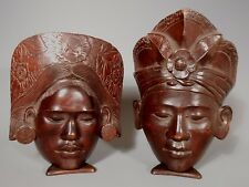 PAIR INDONESIAN BALINESE HAND CARVED WOOD MAN & WOMAN HEAD SCULPTURES ca. 1949