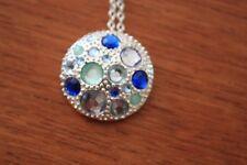 New Avon Pretty Round Pendant silver colour blue & clear stones 1 inch diameter
