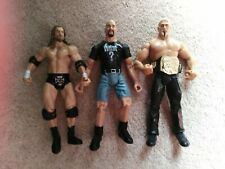 WWE Figures x3 including Stone Cold Steve in What? T shirt Jakks