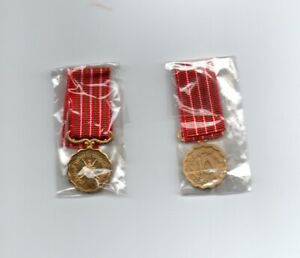 OMAN 15TH ANNIVERSARY . A SUPERB MINIATURE MEDAL.WITH RIBBON