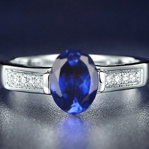 1.70Ct Natural Royal Blue Tanzanite With White Accents Ring In 14KT White Gold
