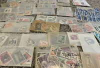 WORLDWIDE MINT STAMPS LOT IN GLASSINES OFF PAPER. MANY WW COUNTRIES. NO U.S.