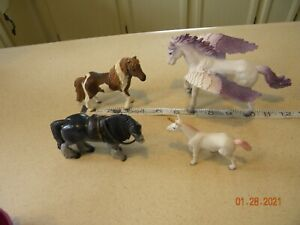 Lot of Four Small Plastic Horses Used