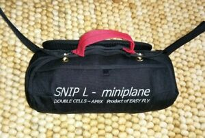 "Paramotor:  ""Miniplane Snip L"" Reserve Parachute and Front Mounted Container."