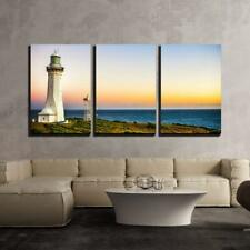"""Wall26 - the Lighthouse in the Sunset - Canvas Art Wall Decor - 16""""x24""""x3 Panels"""