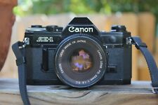 Canon AE-1 35mm SLR Film Camera in Black with Canon FD 50mm F1.8 S.C. Lens