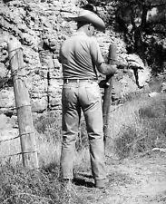 Willis Rue Western Photo Portrait of Cowboy repairing post on barbed wire fence