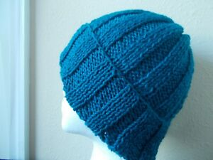 Hand knitted cozy and warm 100% wool hat, dark teal