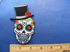 skull, fancy design, with top hat and rose patch