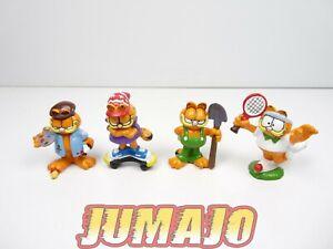 FIG35 lot 4 figurines PVC GARFIELD 4 cm tennis skate peintre cultivateur