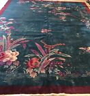 ART DECO CHINESE RUG, AN ATTRACTIVE DARK GREEN BACKGROUND COLOR ART DECO CH