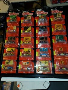 LOT OF 20 1/64 Racing Champions nascar 1996 & 1997 race cars with diecast emblem