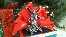 00004000 stained glass Cast Fairy w Red Wings sitting on a rose bud Ooak