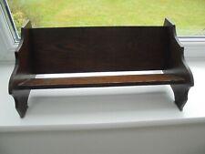 Small vintage dark oak book trough, park bench shaped book rest shelf