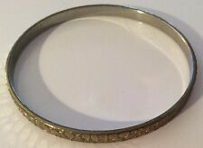 Gold Coloured Solid Metal Bangle With Tiled Design.    5mm Wide.7cm Diameter