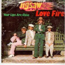 """<1576> 7"""" Single: Jigsaw - Love Fire / Your Lips Are Close"""